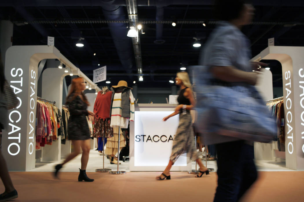 Attendees walk the show floor during the first day of the MAGIC trade show at the Las Vegas Con ...