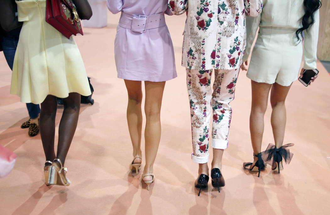 Influencers walk the show floor during the first day of the MAGIC trade show at the Las Vegas C ...