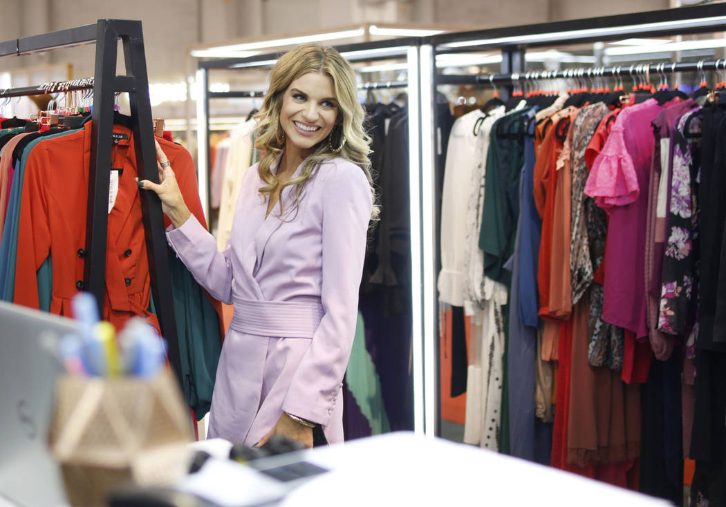 World renowned model, and panel host Rachel McCord looks at a collection by One One Six during ...