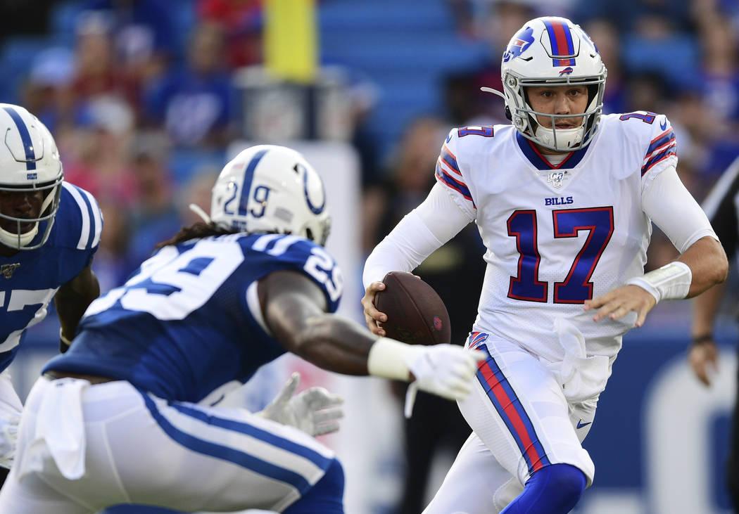 Buffalo Bills quarterback Josh Allen (17) runs with the ball during the first half of an NFL pr ...