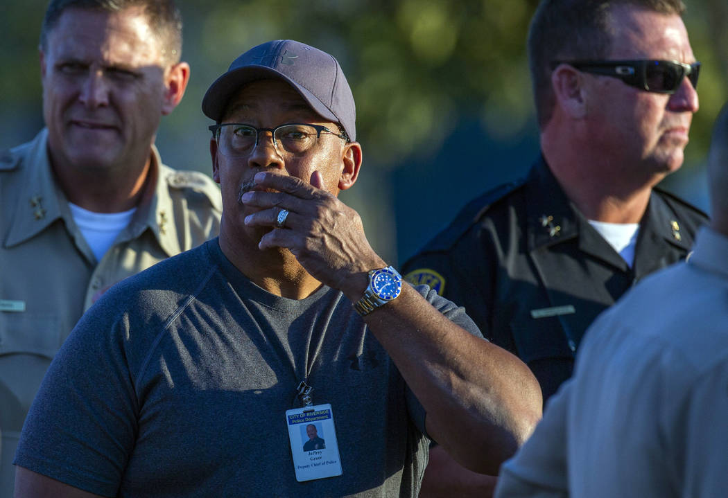 Riverside City Deputy Chief of Police Jeffrey Greer reacts at the scene where a shootout near a ...
