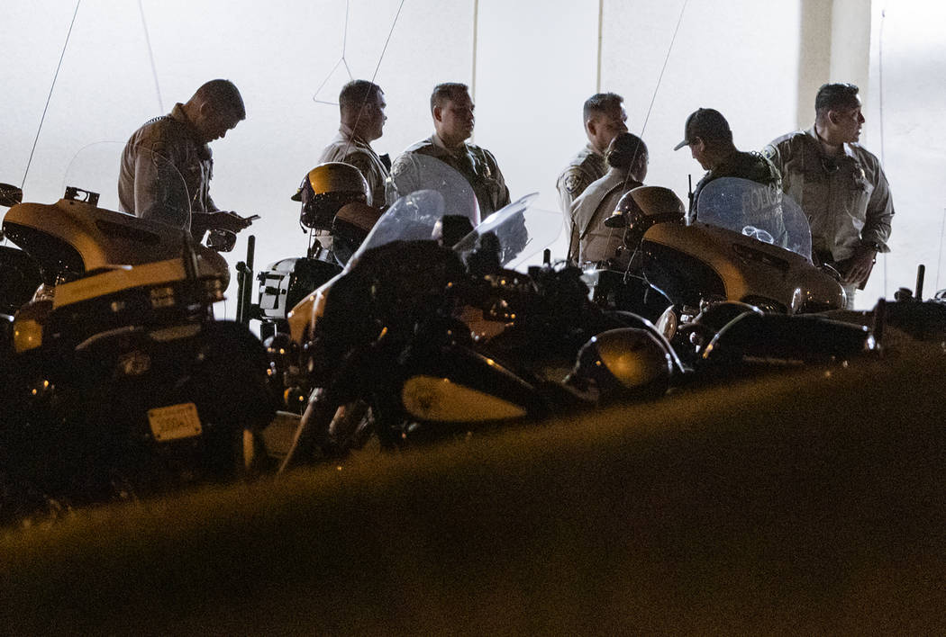 California Highway Patrol officers stage outside an emergency room entrance, late Monday, Aug. ...