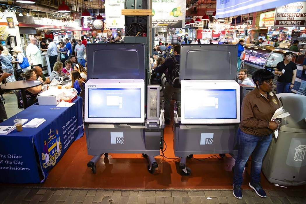 In a June 13, 2019, file photo, ExpressVote XL voting machines are displayed during a demonstra ...