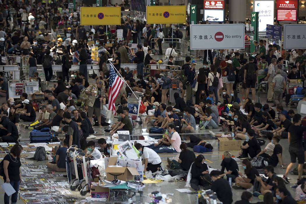 Protesters stage a sit-in rally at the arrival hall of the Hong Kong International Airport in H ...