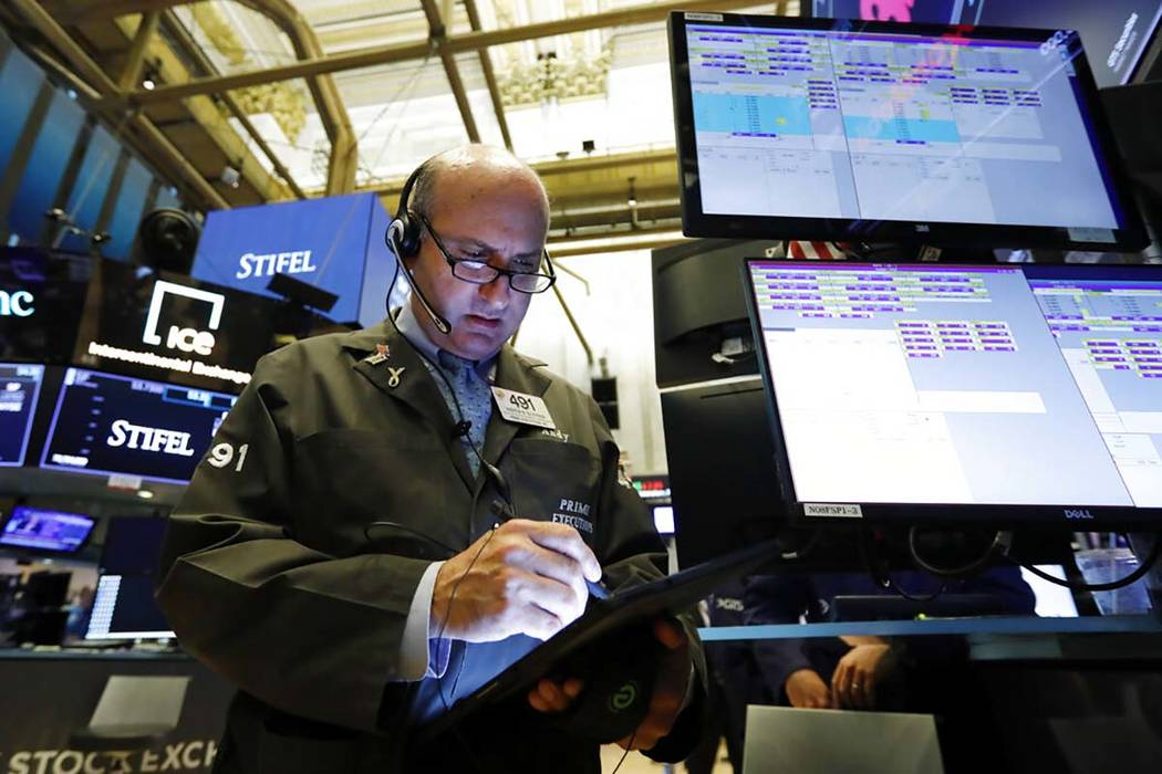 In a Aug. 6, 2019, file photo, trader Andrew Silverman works on the floor of the New York Stock ...
