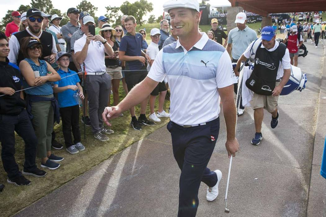 American golfer Bryson DeChambeau walks to the fairway after teeing off from the 17th box durin ...
