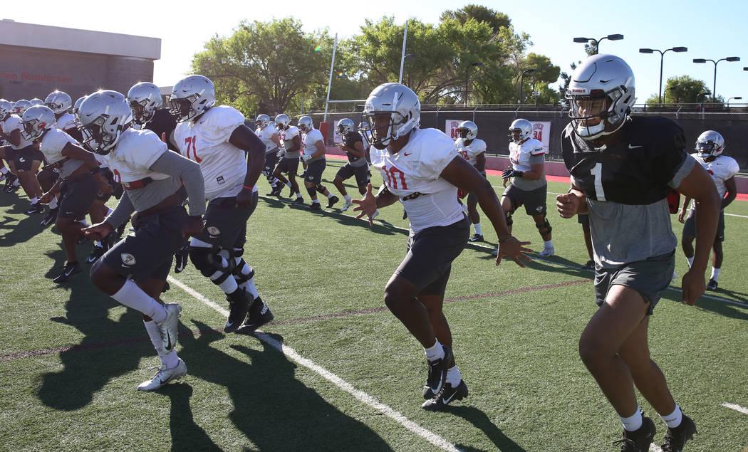 UNLV Rebels quarterback Armani Rogers (1) and wide receiver Darren Woods Jr. (10), second right ...