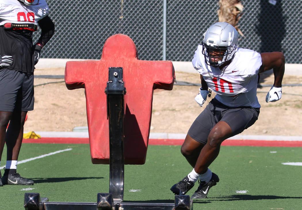 UNLV Rebels wide receiver Darren Woods Jr. (10) prepares to hits the sled during team practice ...