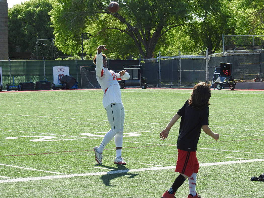 UNLV wide receiver Darren Woods Jr. plays catch with Thaddeus Thatcher, who signed had a ceremo ...