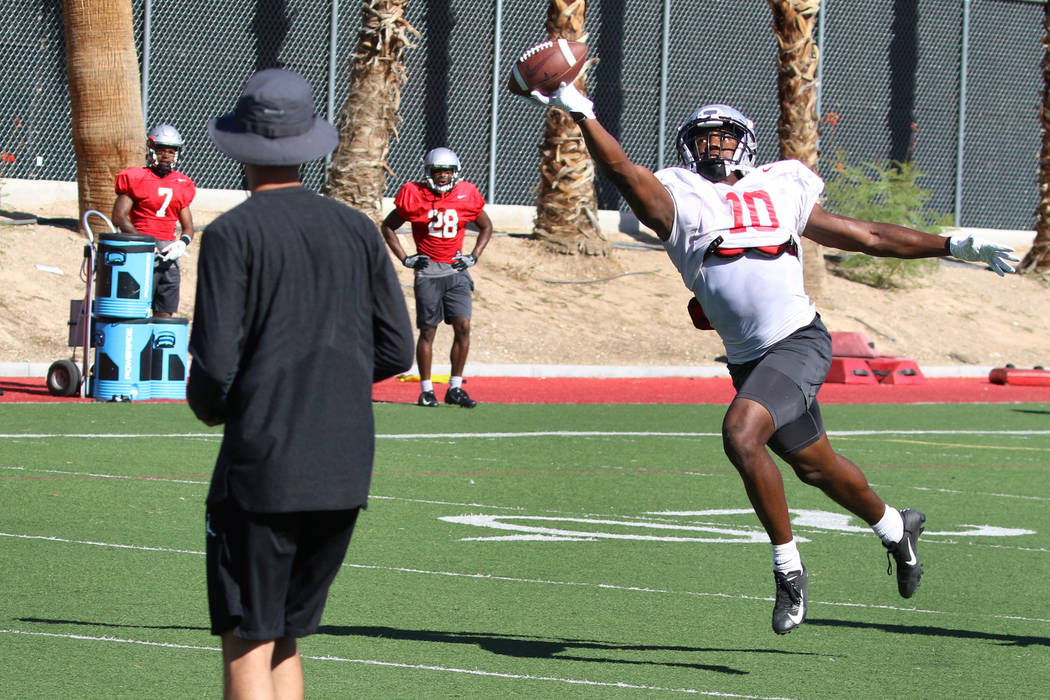 UNLV Rebels wide receiver Darren Woods Jr. (10) catches a pass during team practice on Tuesday, ...