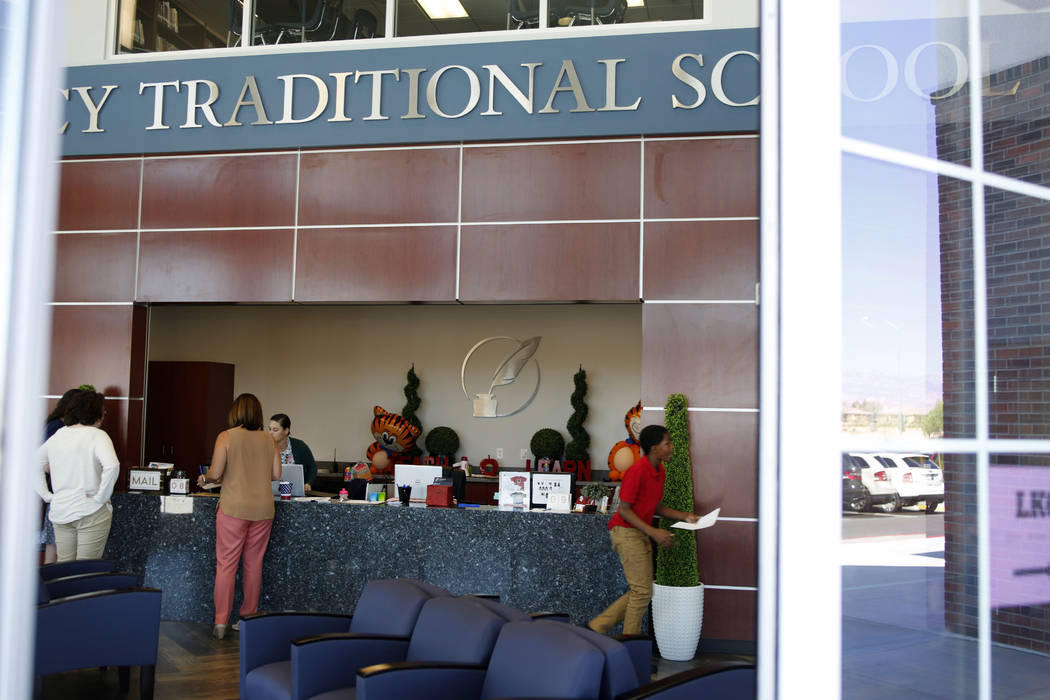 Students and faculty in the lobby of Legacy Traditional School during the opening week of the s ...
