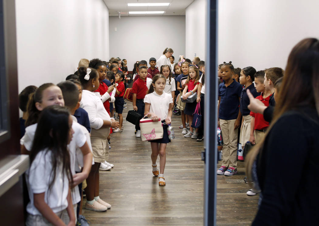 Legacy Traditional School students line up for their lunch during the opening week of the south ...