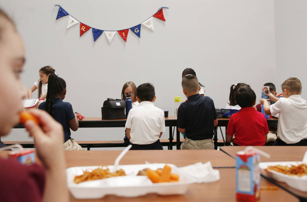Legacy Traditional School students eat lunch during the opening week of the southwest Las Vegas ...