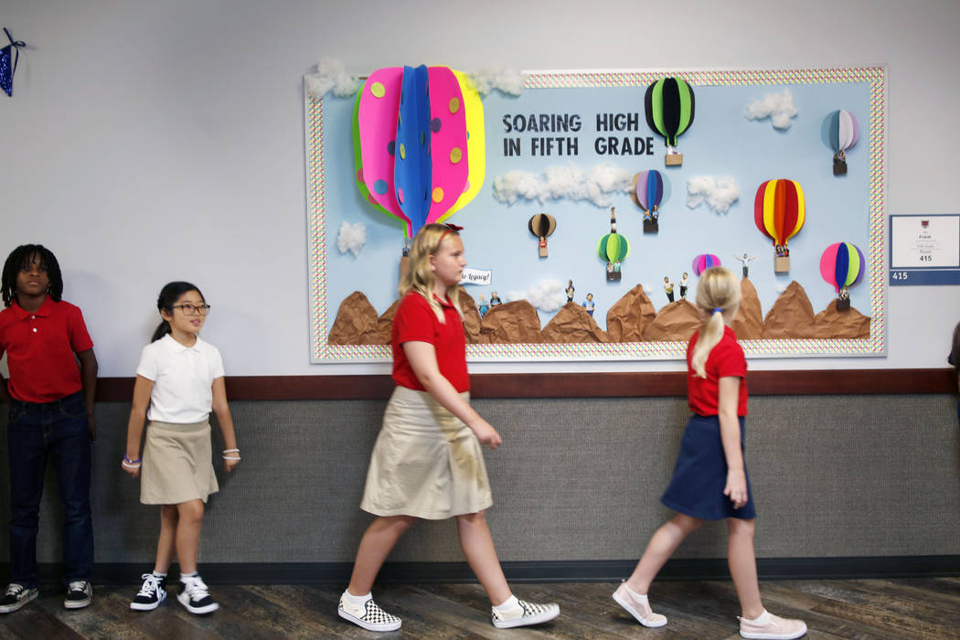Legacy Traditional School students transitions class periods during the opening week of the sou ...