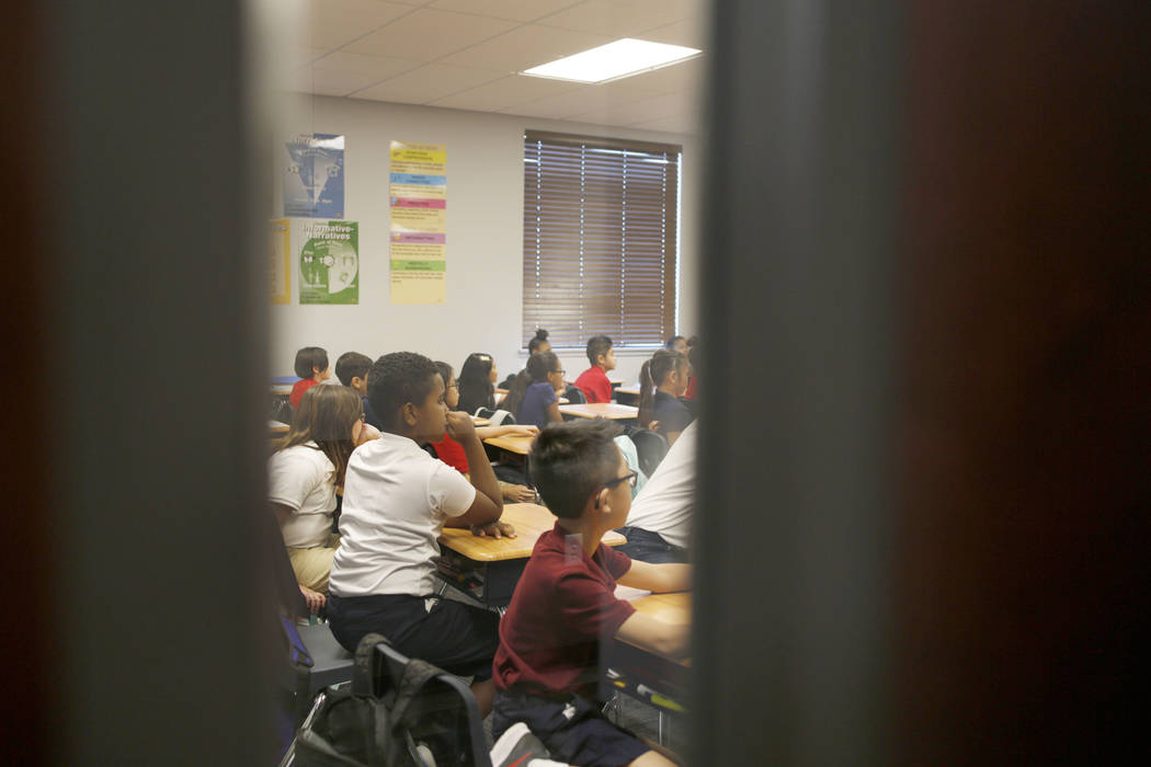 Students participate in their fifth grade class at Legacy Traditional School during the opening ...
