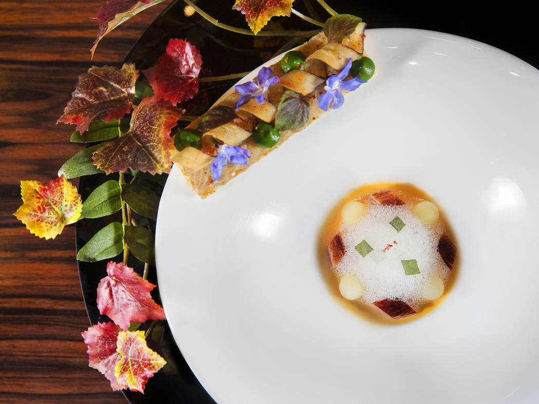 Le Topinambour with sunchoke veloute, parmesan custard and smoked bacon at Joel Robuchon at the ...