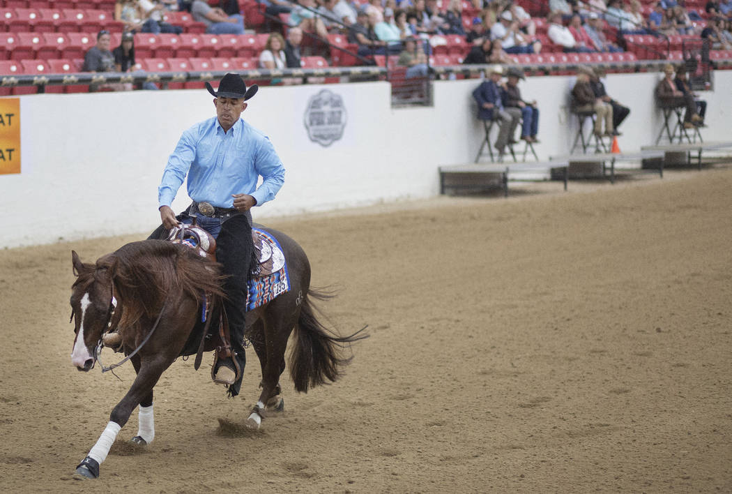 Reining expert Matt Mills practices his reining pattern at the South Point Arena in Las Vegas o ...