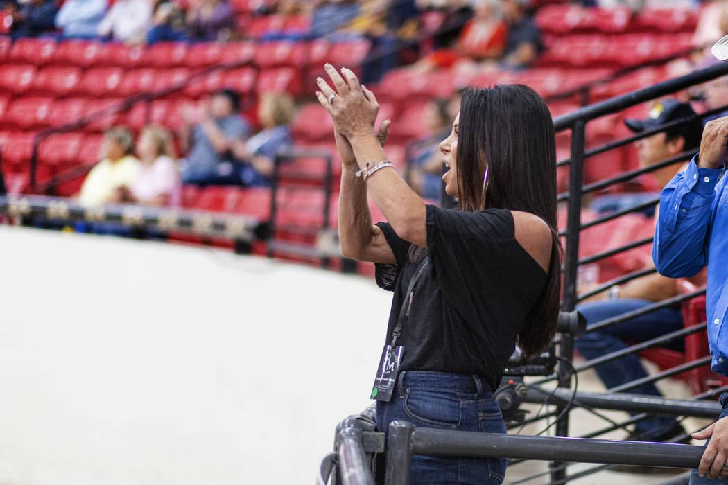 Karen Mills cheers on her husband reining expert Matt Mills at the South Point Arena in Las Veg ...