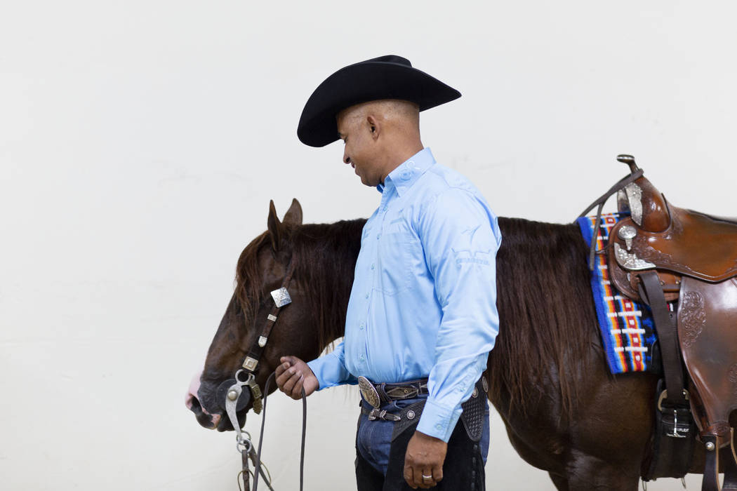 Reining expert Matt Mills finishes practicing his reining pattern at the South Point Arena in L ...