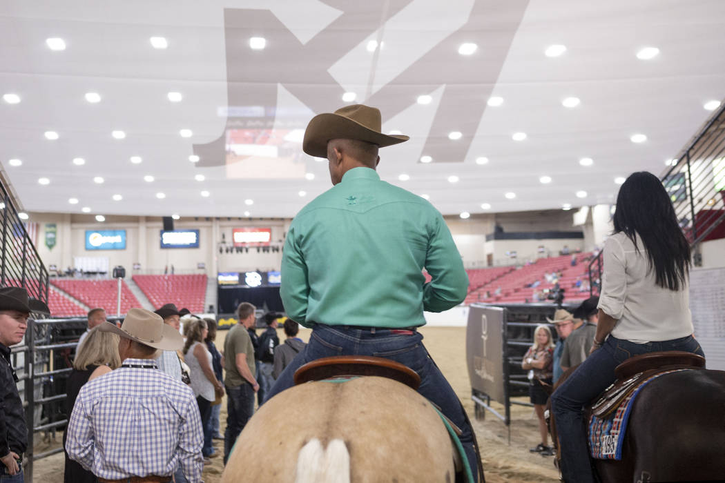 Reining expert Matt Mills, center, at the South Point Arena in Las Vegas on Friday, Aug. 16, 20 ...
