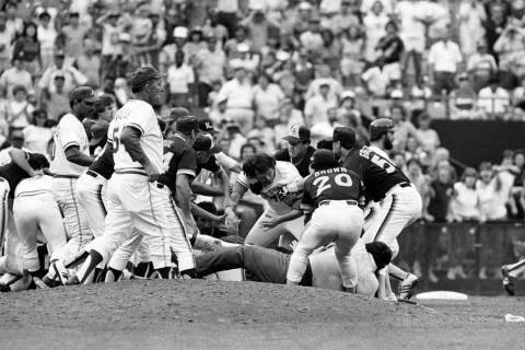 Atlanta Braves Rick Mahler, center, is dragged away by San Diego Padres Rich Gossage, right, Bo ...