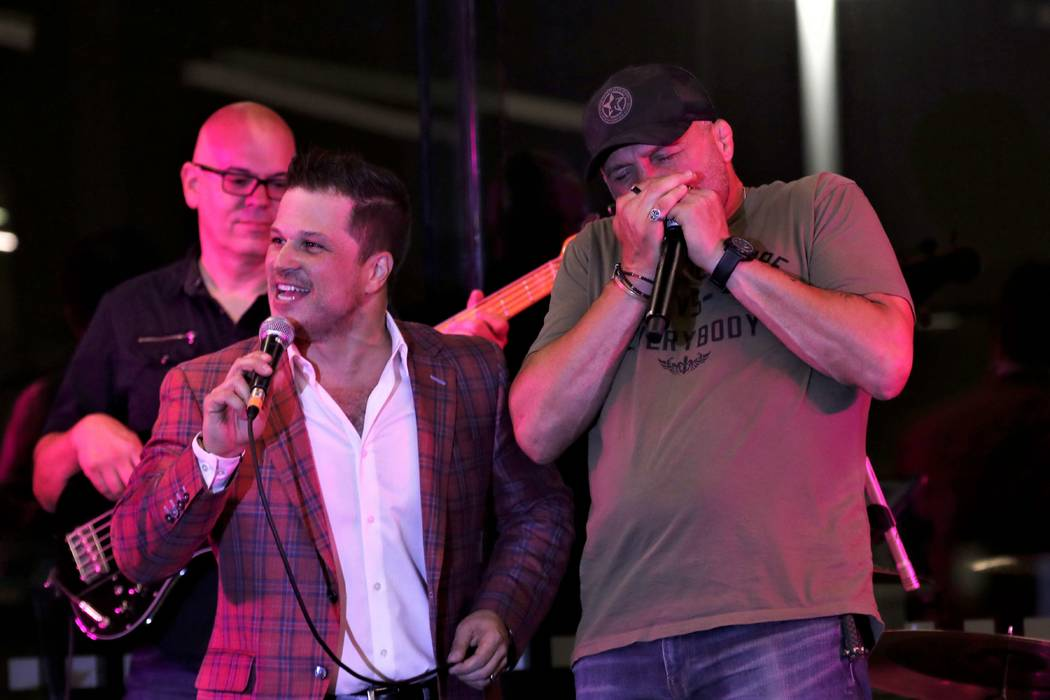 "Mondays Dark founder Mark Shunock and UFC legend Randy Couture perform ""A Hard Day's Night"" at ..."