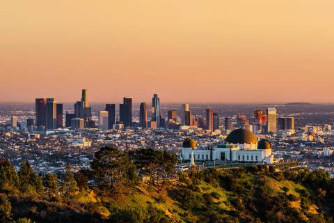 Los Angeles skyscrapers and Griffith Observatory at sunset (Getty Images)