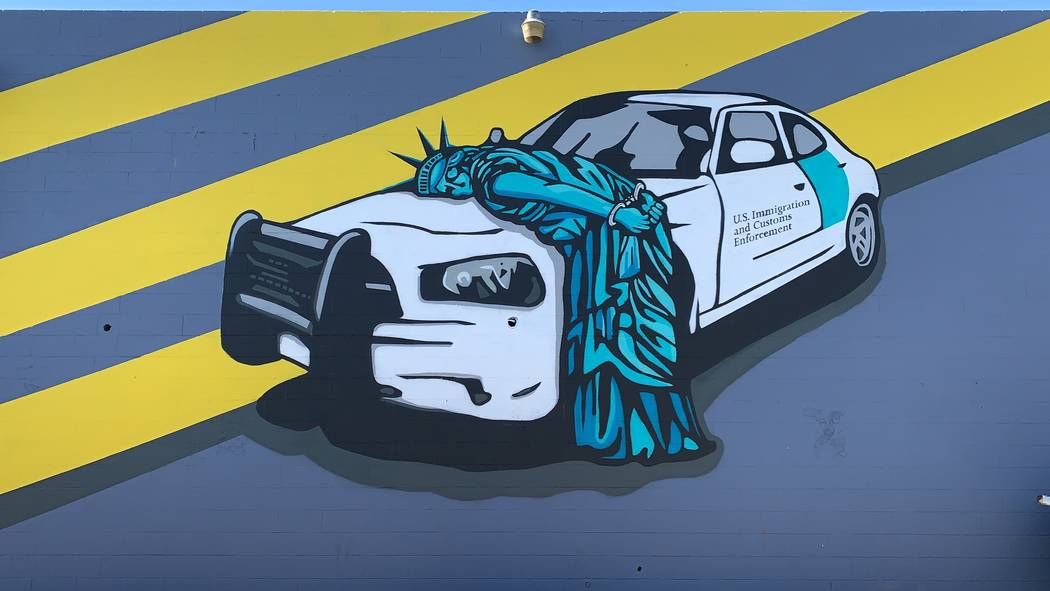 Recycled Propaganda's mural in the Arts District depicting the Statue of Liberty being arrested ...