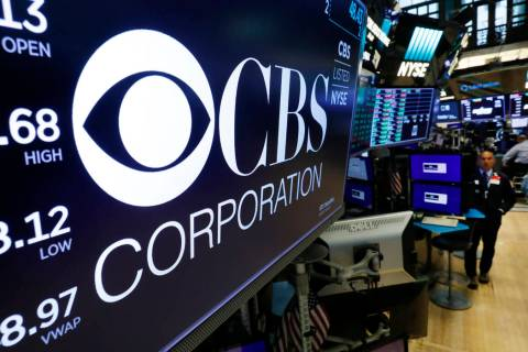 The logo for the CBS Corporation appears above a trading post on the floor of the New York Stoc ...