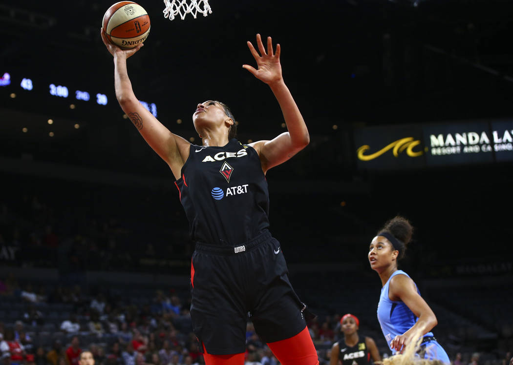 Las Vegas Aces center Liz Cambage goes to the basket against the Atlanta Dream during the first ...