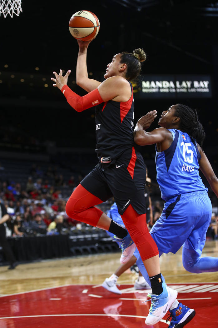 Las Vegas Aces' Kayla McBride goes to the basket past Atlanta Dream's Tiffany Hayes (15) during ...