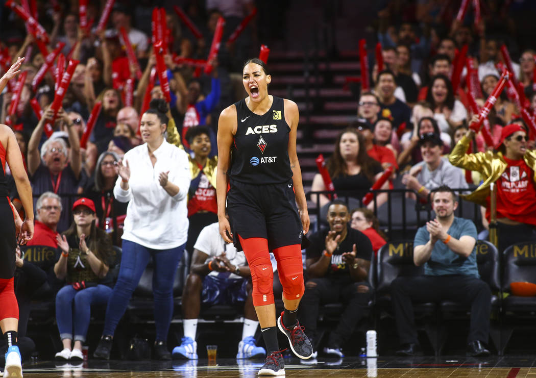 Las Vegas Aces' Liz Cambage celebrates during the second half of a WNBA basketball game against ...