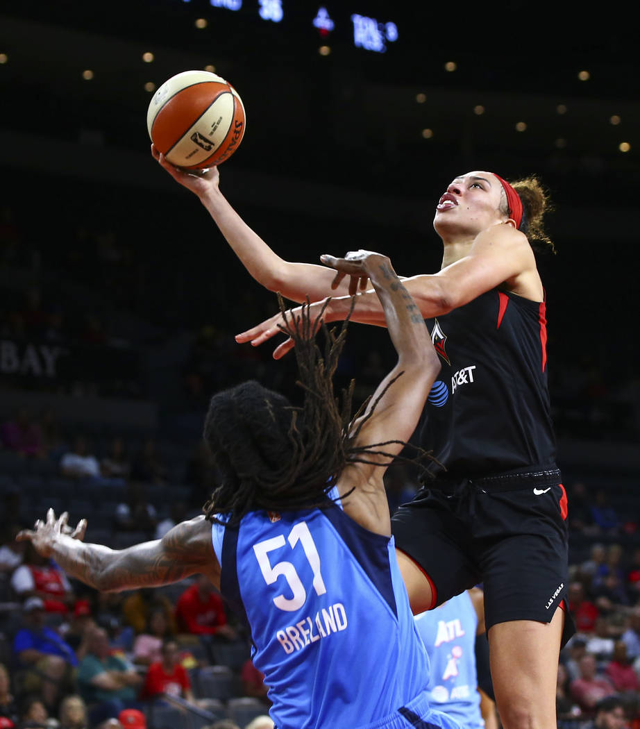 Las Vegas Aces' Dearica Hamby goes to the basket against Atlanta Dream's Jessica Breland (51) d ...