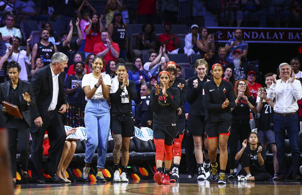 Las Vegas Aces players cheer as the team wins over the Atlanta Dream in a WNBA basketball game ...