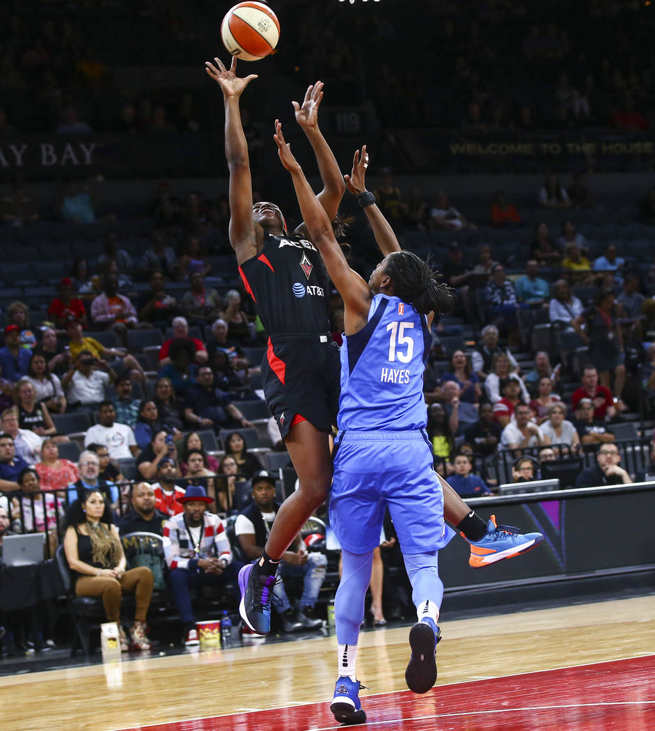 Las Vegas Aces' Jackie Young shoots against Atlanta Dream's Tiffany Hayes (15) during the secon ...