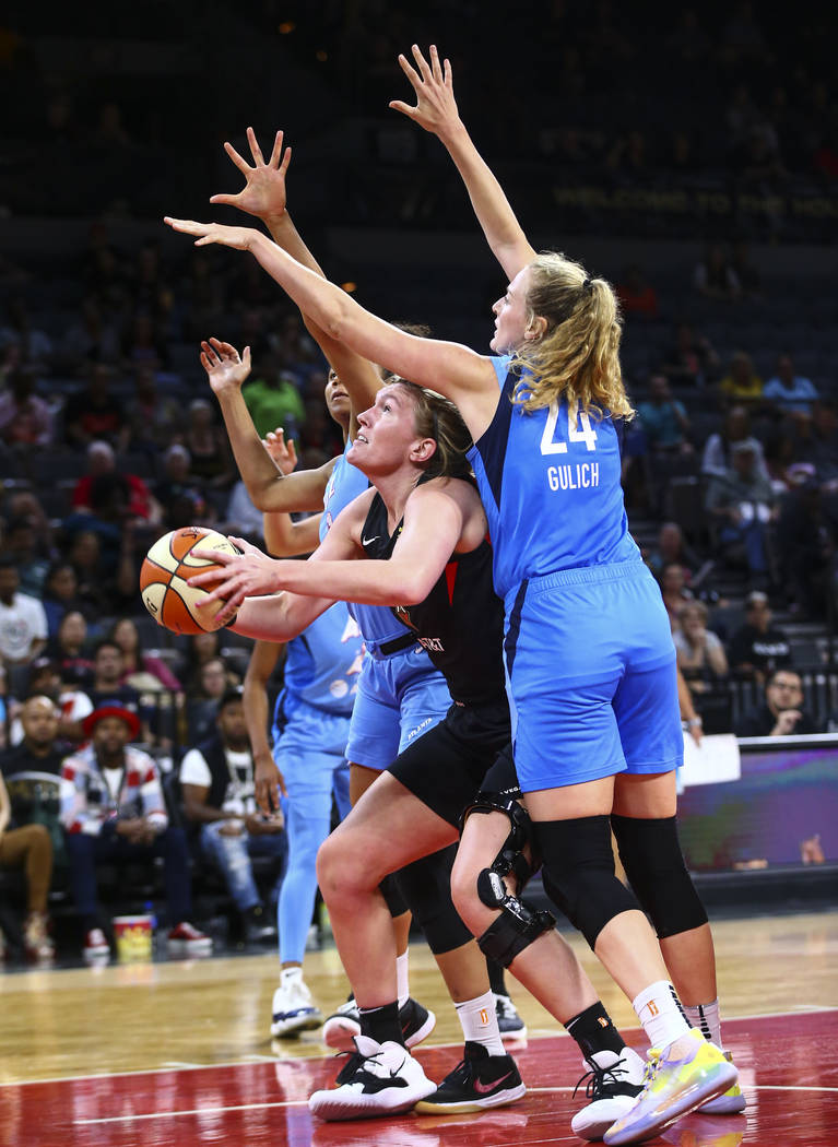 Las Vegas Aces center Carolyn Swords looks to shoot under pressure from Atlanta Dream's Marie G ...