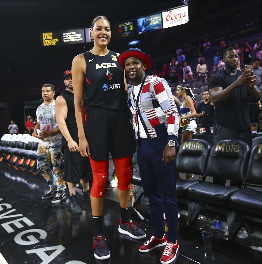 Las Vegas Aces' Liz Cambage poses with boxer Floyd Mayweather after a WNBA basketball game at t ...
