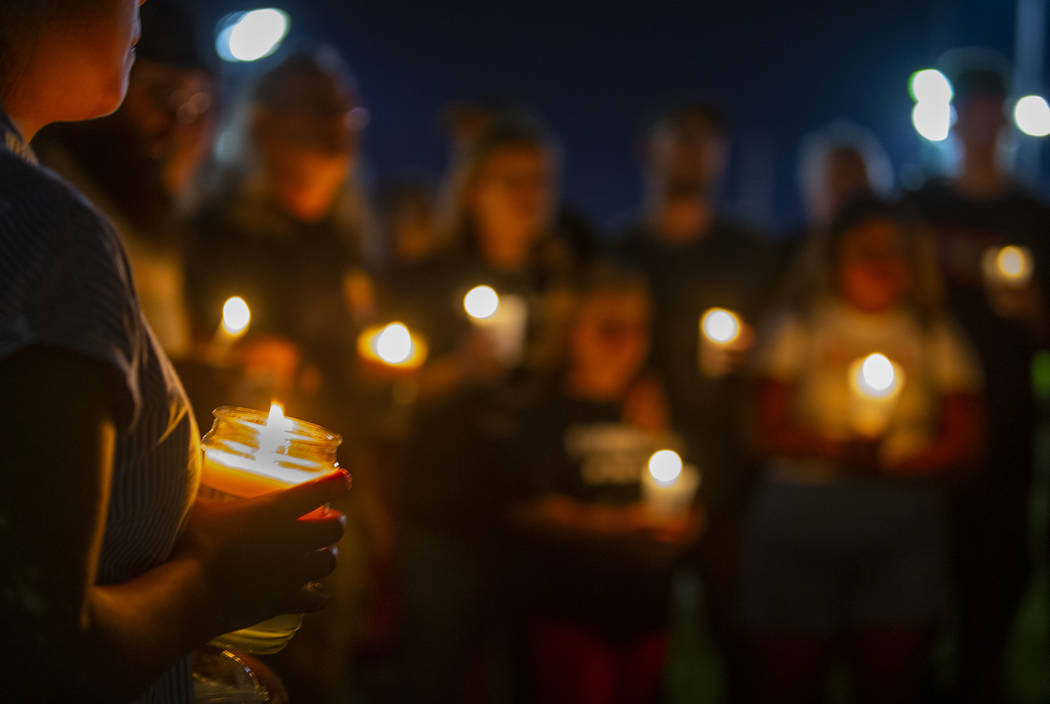 A silent prayer is said during a candlelight vigil for Harlee Deborski and Timothy Bailey at De ...