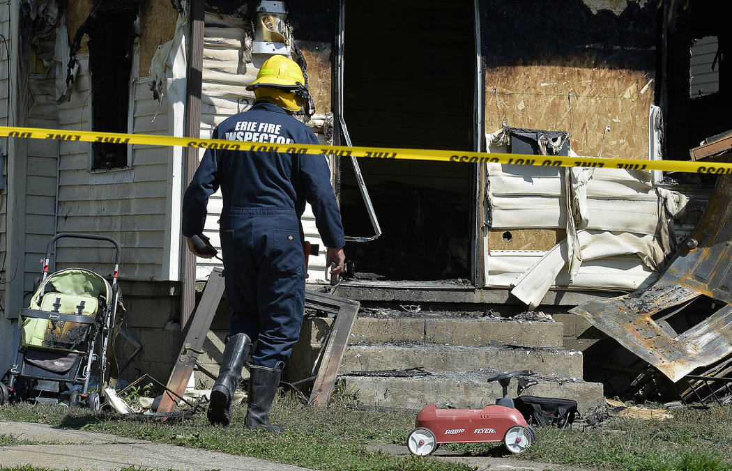 Erie Bureau of Fire Inspector Mark Polanski helps investigate a fatal fire at 1248 West 11th St ...