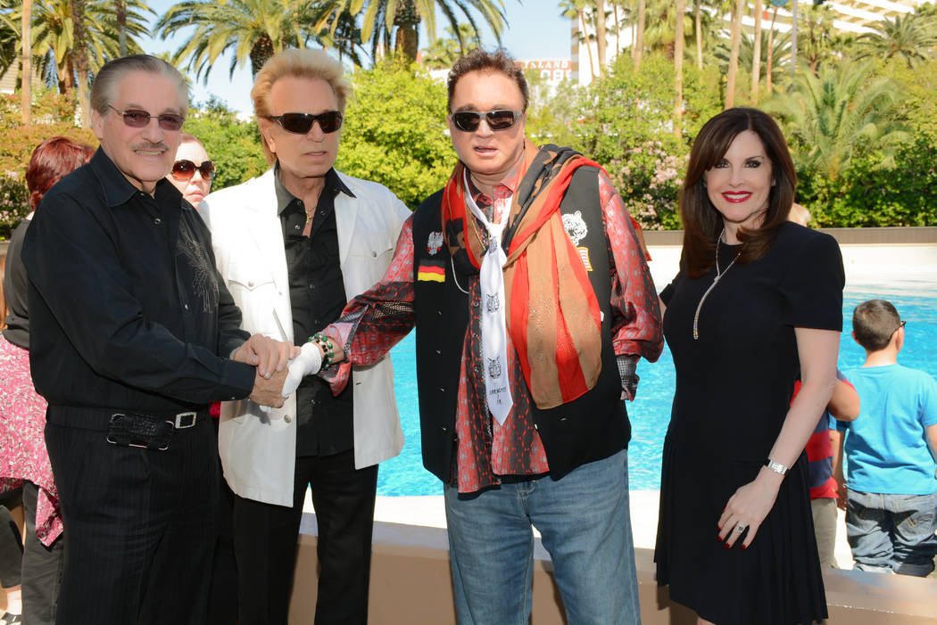 Morgan and Karen Cashman are shown with two favorite entertainers, Siegfried & Roy at the Lady ...