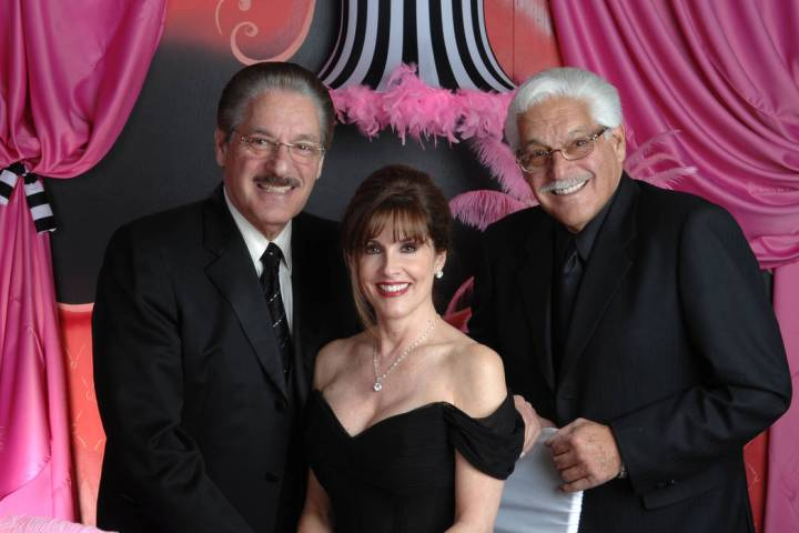 Morgan and Harris Cashman are shown with Morgan's wife, Karen. (Cashman Photo)