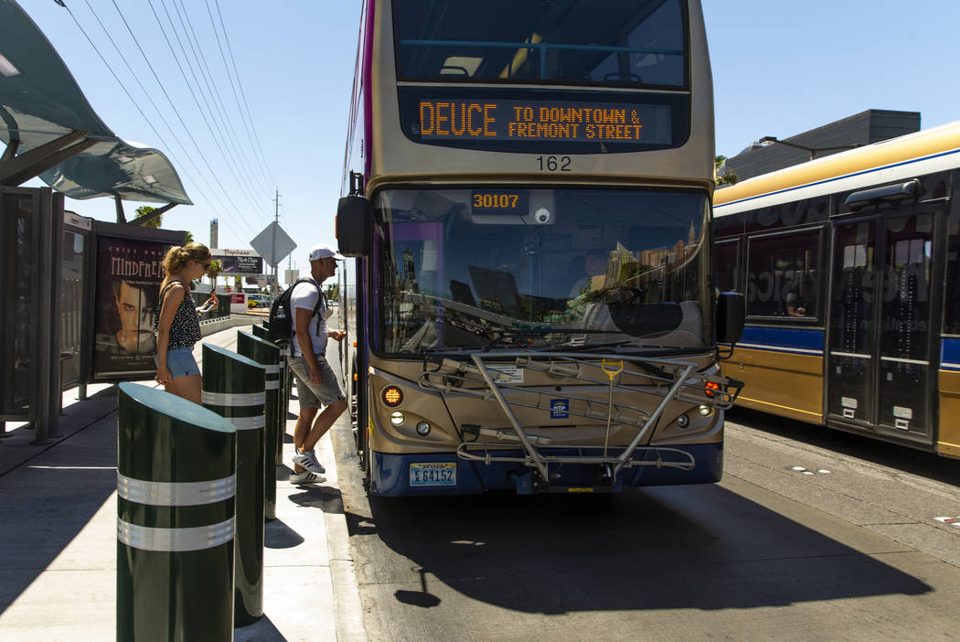Passengers board an RTC bus near the Tropicana on the Strip on Tuesday, Aug. 13, 2019 in Las Ve ...