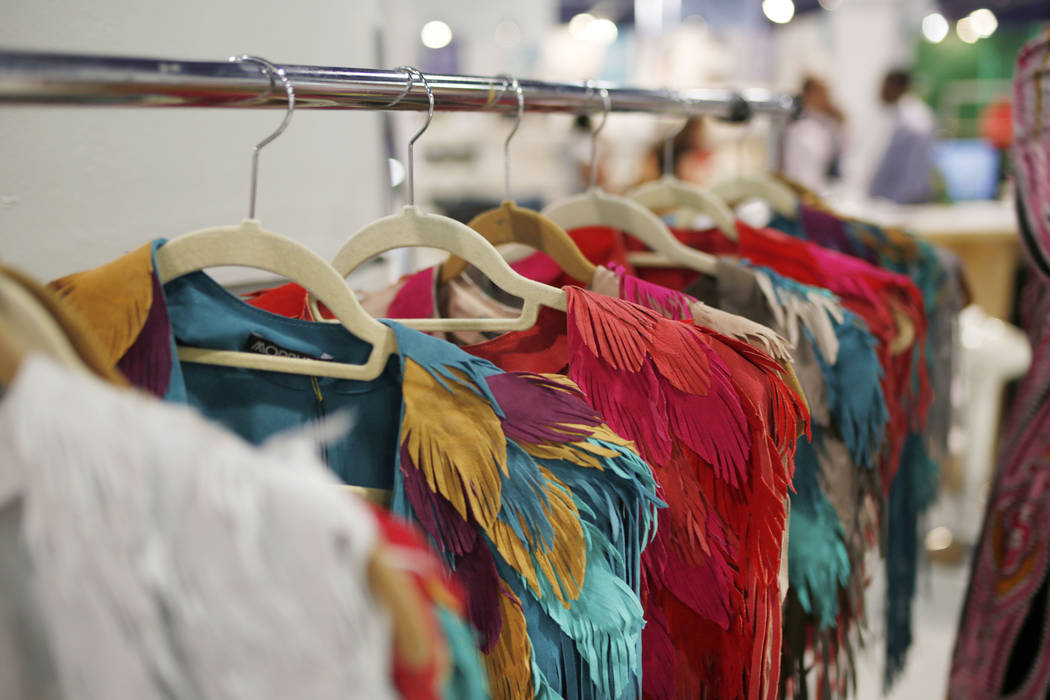 Handmade feather leather shells are displayed at the Morphew exhibit during the second day of t ...