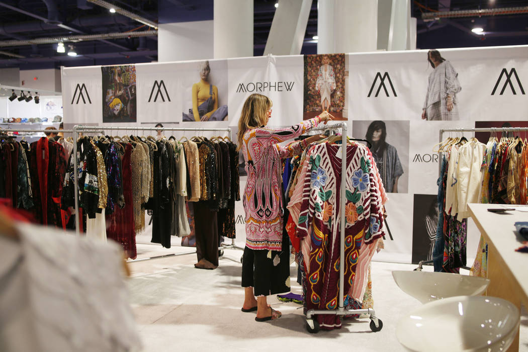 Morphew founder Bridgette Morphew sorts through Morphew pieces at her exhibit during the second ...