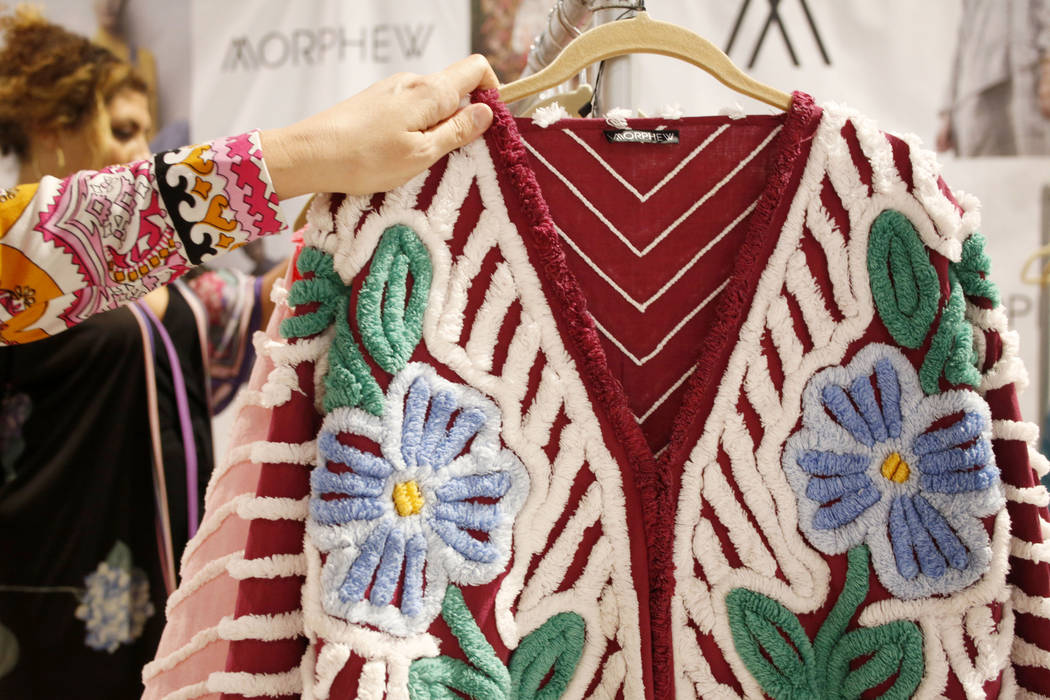 Morphew founder Bridgette Morphew holds a handmade Morphew collective 1950s chenille patchwork ...