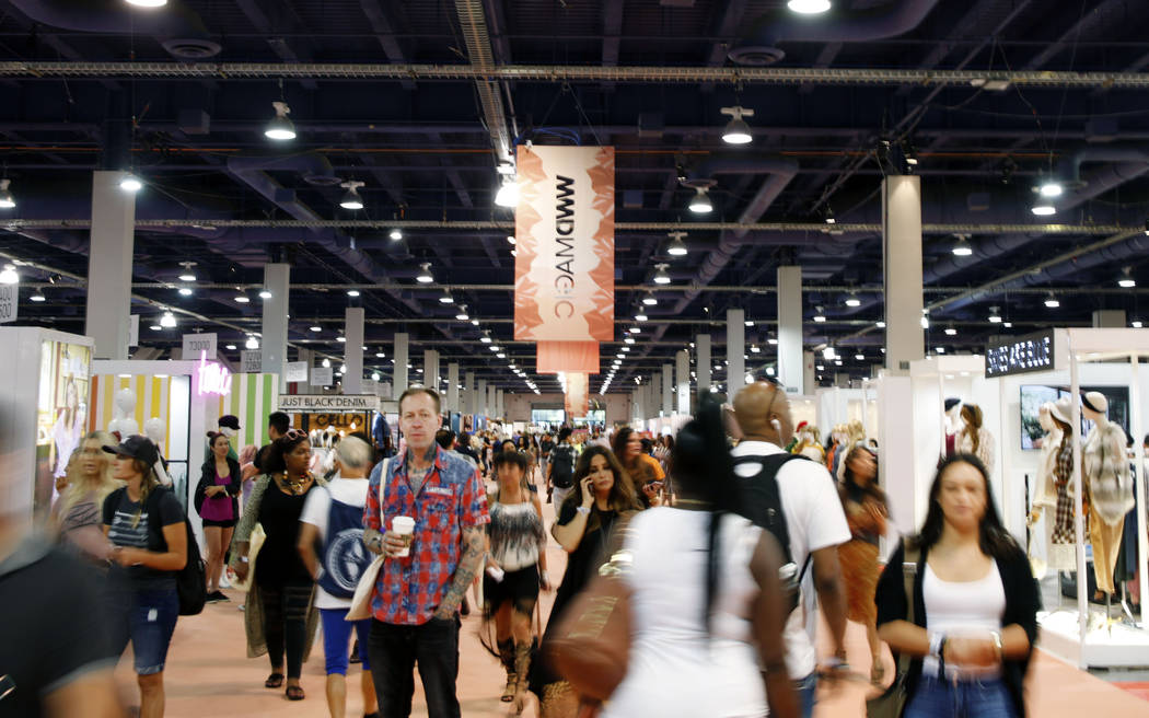 Attendees walk the show floor during the second day of the MAGIC trade show at the Las Vegas Co ...