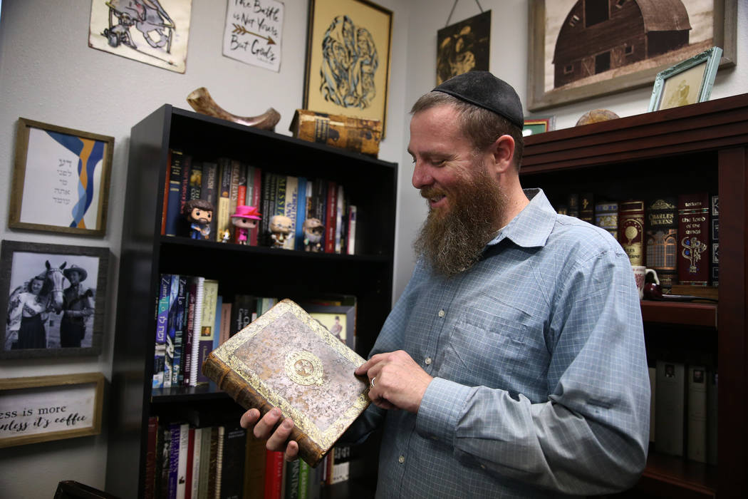 Rabbi Jered Hundley shows his book collection inside the Lev HaShem Messianic Synagogue in Las ...