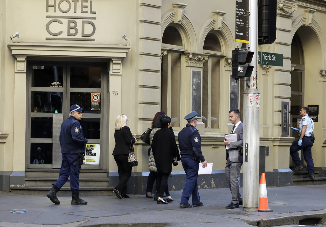 Police work at a scene where a man attempted to stab multiple people in Sydney, Australia, Tues ...