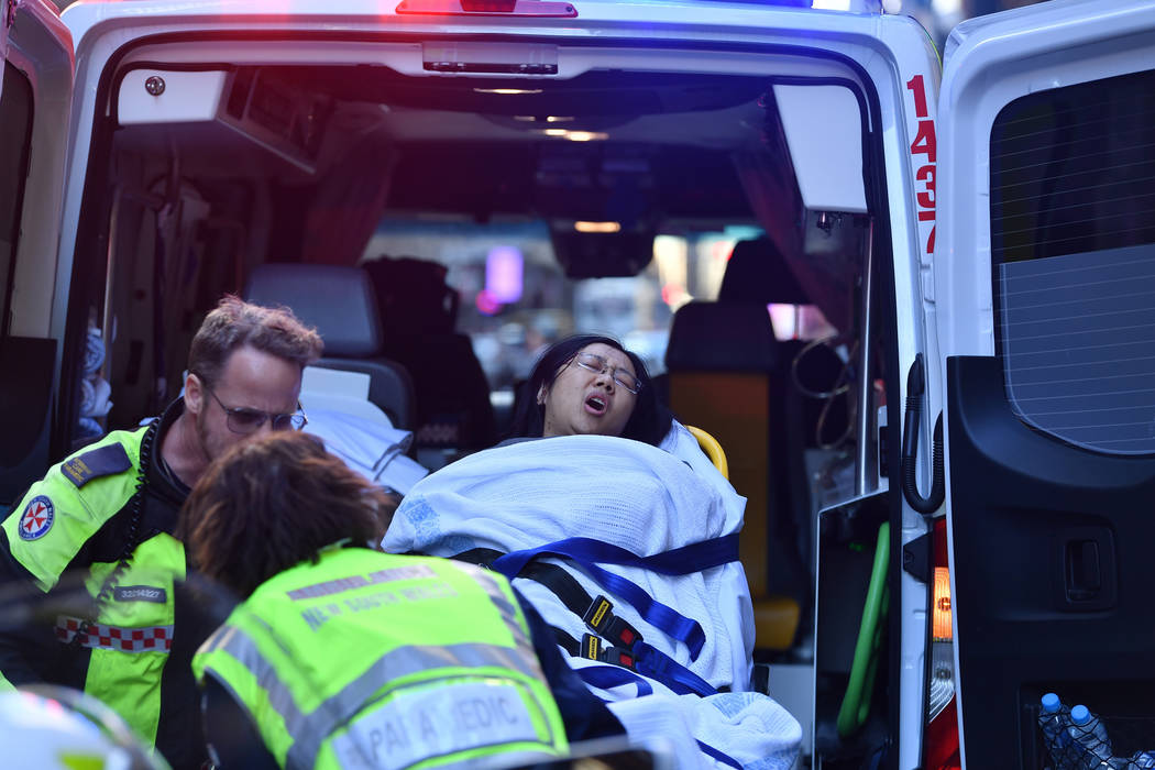 A women is taken by ambulance from Hotel CBD at the corner of King and York Street in Sydney, A ...