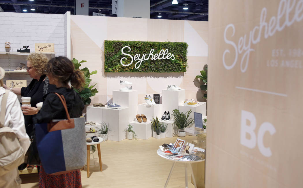 Individuals visit the Seychelles exhibit during the second day of the MAGIC trade show at the L ...
